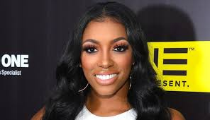How tall is Porsha Williams Height Weight Body Measurements